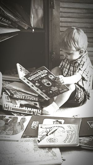 Reading A Book Toddlerlife Toddler Boy Toddlerstories Check This Out Children Photography BoysBoysBoys Black And White Photography Black And White Readingtime Reading Books Read A Book