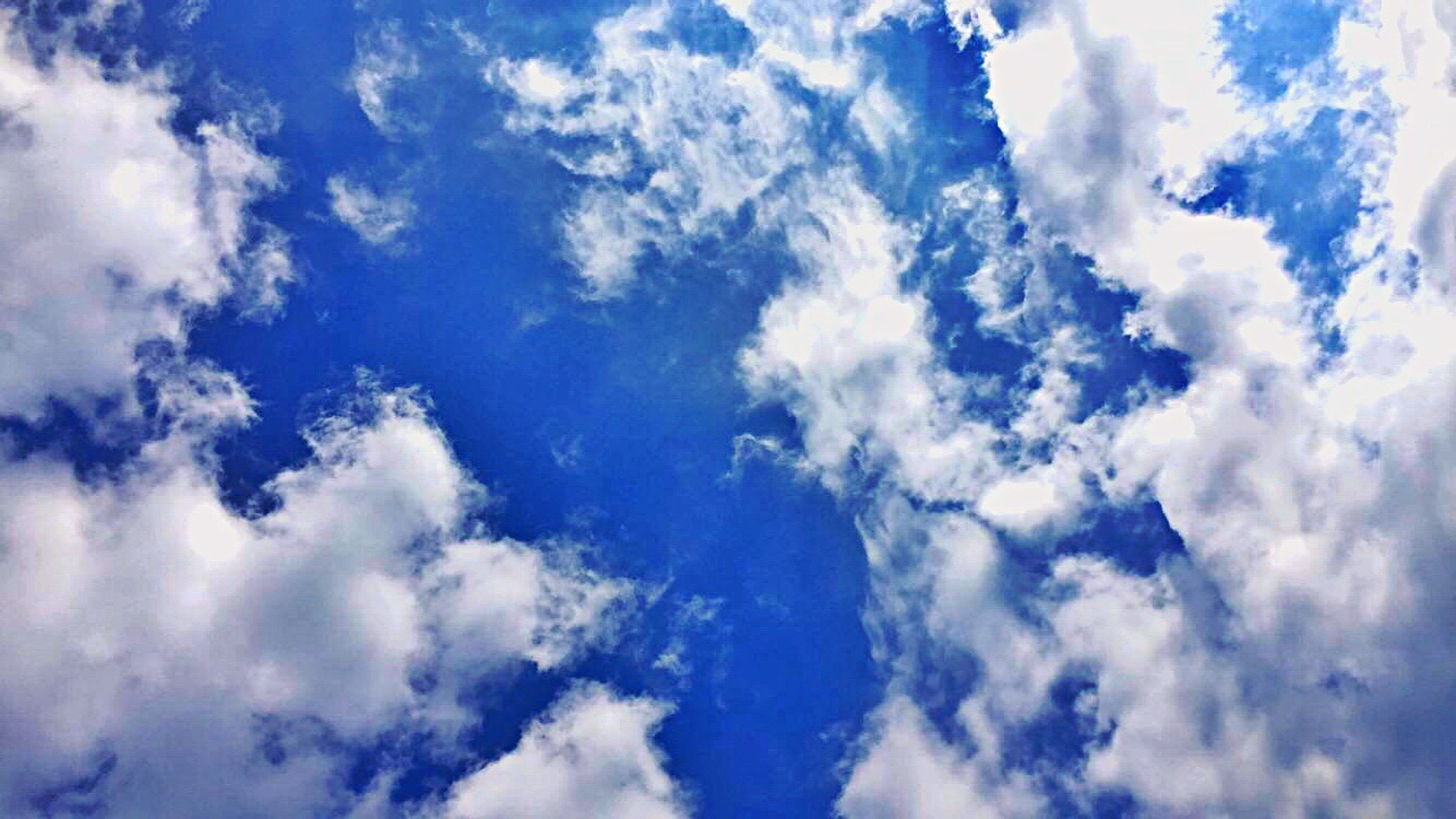 low angle view, blue, scenics, beauty in nature, tranquility, tranquil scene, sky, cloud - sky, nature, white, cloud, backgrounds, majestic, white color, day, sky only, idyllic, heaven, outdoors, full frame, cloudscape, meteorology, cloudy, fluffy, cumulus cloud, dreamlike
