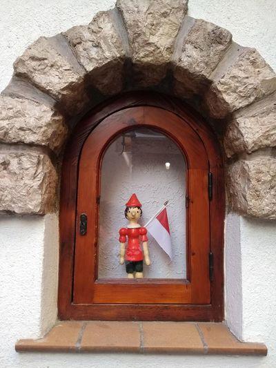 Open door on wall of building