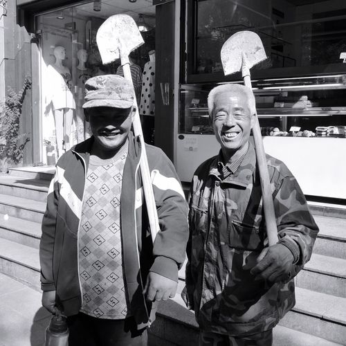 Real People Two People Traditional Clothing Cultures Men Outdoors Tradition Day Togetherness Building Exterior Architecture Only Men Adult Adults Only People Worker On Chinese Streets China Photos On The Streets The Street Photographer - 2017 EyeEm Awards The Photojournalist - 2017 EyeEm Awards Chinese Street Workers Construction Work In China China Photos China. Stories From The City