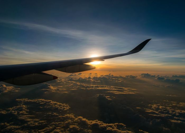 Above the clouds Airplane Flying Sunset Aerial View Sea Blue Commercial Airplane Sky Landscape Cloud - Sky Aircraft Wing Plane Airplane Wing First Eyeem Photo