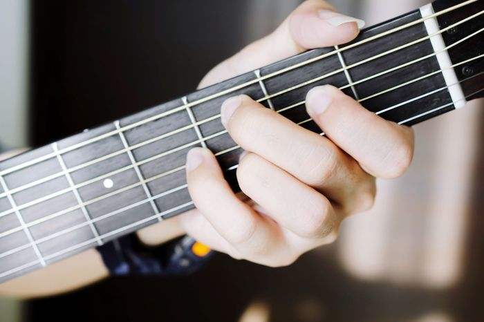 Music Musical Instrument Guitar Musical Instrument String Arts Culture And Entertainment Human Hand Fretboard Playing Human Body Part Musician Indoors  Close-up Plucking An Instrument Classical Guitar One Person People Day Jazz Music Chord Lesson