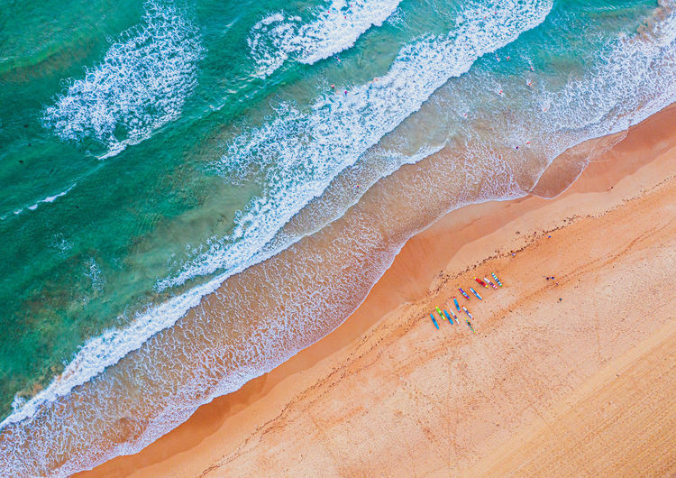 High angle view of people and waves on beach