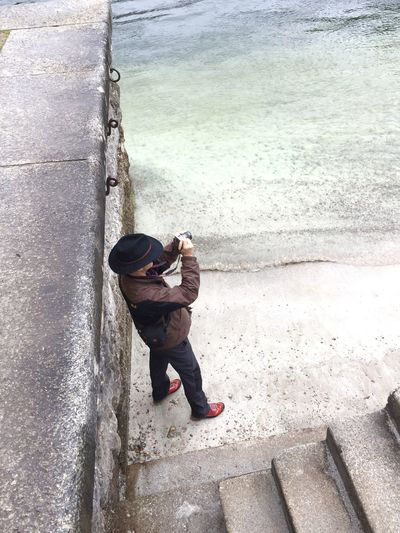 High angle view of man photographing at beach