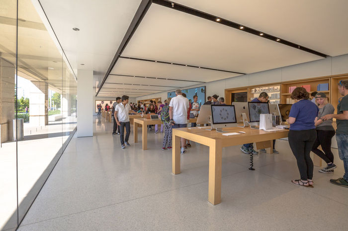 Cupertino, California, United States - August 15, 2016: the Apple world headquarters at One Infinite Loop. Apple is a multinational that produces consumer electronics, personal computers and software. people come from the popular Apple store of Apple Inc Headquarters at One Infinite Loop located in Cupertino, Silicon Valley, California. Apple California IT Mac PC United States Adult Building Computer Cupertino Day Electronics Industry Flag Full Length Group Of People Headquarter Headquarters Hq IMac27 IPhone Imac Indoors  Infinite Loop Large Group Of People Lifestyles Men Mobile People Real People Standing Store Walking Women
