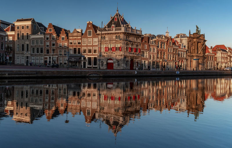 Haarlem cityscape on a nice sunny winter day Reflection Building Exterior Water Built Structure Architecture Waterfront Sky Building Symmetry No People Day Travel Destinations Travel Tourism History Haarlem Cityscape River Netherlands Holland Dutch