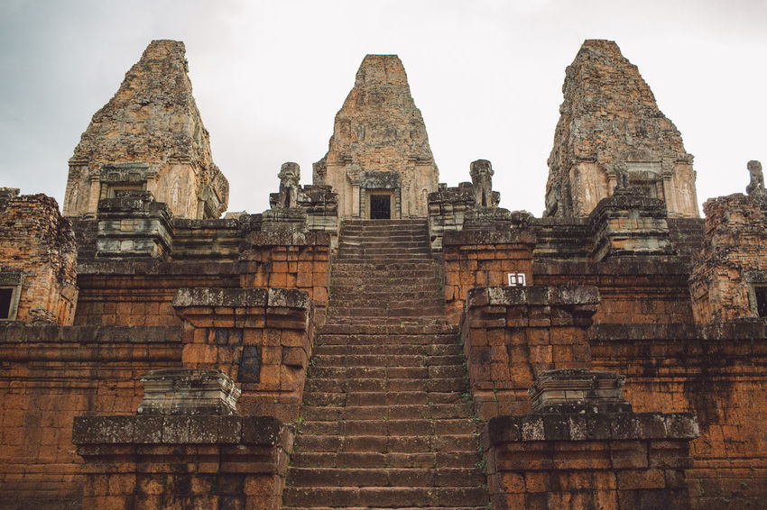 Siem Reap Cambodia Angkor Architecture Built Structure History The Past Sky Place Of Worship Travel Destinations Ancient Old Building Exterior Religion Belief Tourism Spirituality Travel Building Day Old Ruin Low Angle View No People Ancient Civilization Outdoors Ruined Archaeology