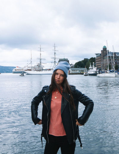 Water One Person Standing Sky Three Quarter Length Front View Young Adult Transportation Cloud - Sky Leisure Activity Architecture Casual Clothing Clothing Young Women Real People Lifestyles Nature Portrait Hair Outdoors Hairstyle Warm Clothing Norway Cold Temperature Girl