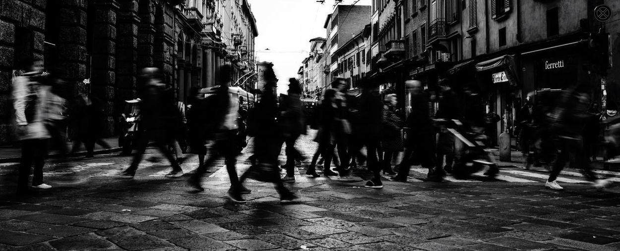 Group of people walking on street in city