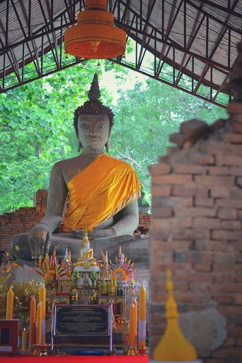Statue of buddha outside building