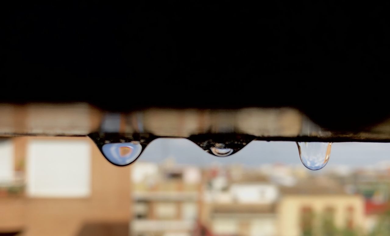focus on foreground, water, close-up, drop, architecture, wet, building exterior, built structure, no people, selective focus, nature, outdoors, day, rain, copy space, city, building, glasses, raindrop, rainy season, personal accessory