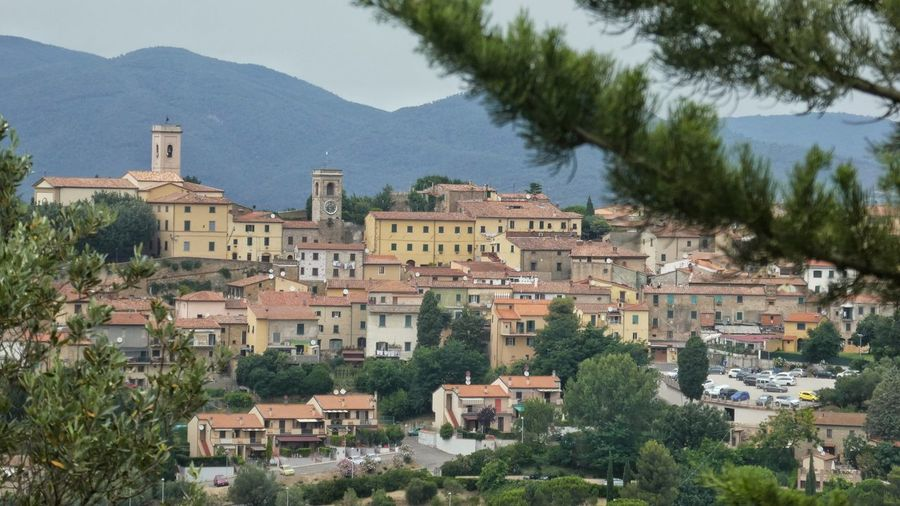 cityview to Montescudaio, beautiful village in Tuscany Beautiful Village Natural Frame Mountain Range Terracotta Color Red Roofs EyeEm Gallery Travel Destinations Tree Cityscape Mountain City Place Of Worship Sky Architecture Building Exterior Built Structure Historic History TOWNSCAPE Housing Settlement Rooftop Town