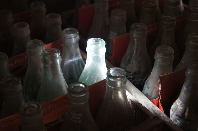 Bottles in shelf