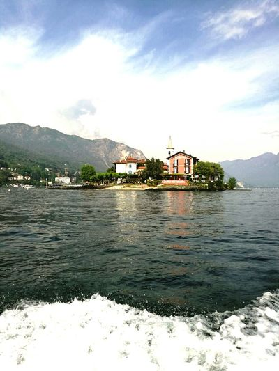 Lago maggiore - Isola bella Flag Building Exterior Day Cloud - Sky Travel Destinations Sky Architecture Outdoors History Water Lake No People Built Structure Mountain Politics And Government Nature First Eyeem Photo