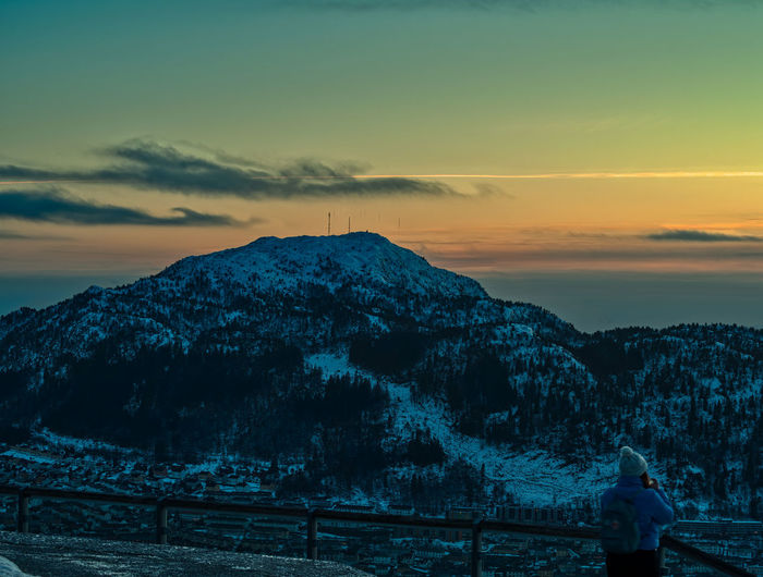 City sunset Sky Sunset Beauty In Nature Scenics - Nature Tranquility Tranquil Scene Nature Mountain Cloud - Sky Water Orange Color Non-urban Scene Real People Cold Temperature Winter Lifestyles Idyllic Snow One Person Outdoors Snowcapped Mountain