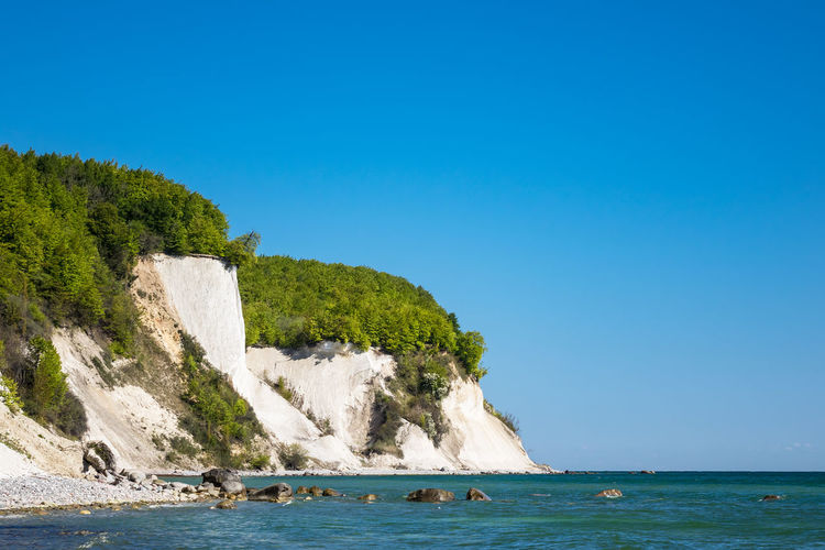 Baltic Sea coast with chalk cliffs on the island Ruegen, Germany. Water Sea Nature No People Landscape Baltic Sea Coast Shore White Cliffs  Chalk Cliffs Ruegen Rügen Germany Mecklenburg-Vorpommern Island Trees Forest Sky And Clouds Cloud - Sky Blue Green Travel Destinations Travel Tourism Vacation