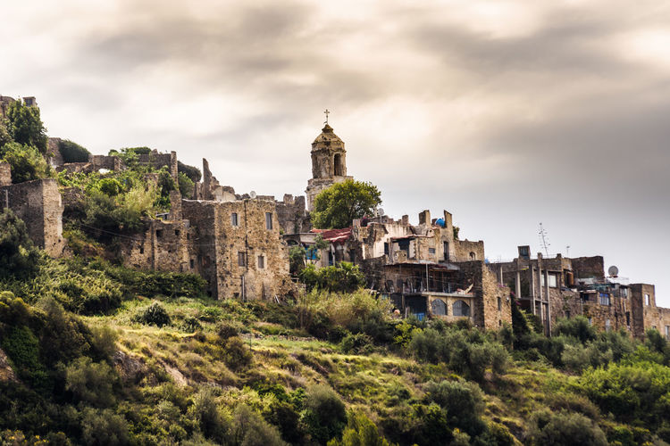 old village Bussana Vecchia Architecture Building Building Exterior Built Structure Castle Cloud - Sky Day History Nature No People Old Outdoors Plant Residential District Sky The Past Tower Travel Travel Destinations Tree