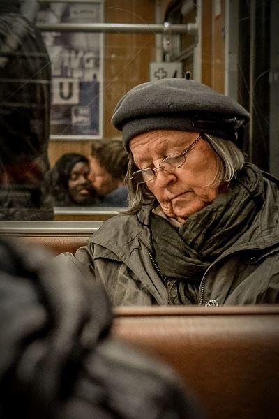 love in the background EyeEm Best Shots Metro People Travel Germany Love Munich Ubahn Cap Reading Old Woman Train Kissing Newspaper Grey Hair Warm Clothing Portrait Close-up Passenger Train Railway EyeEmNewHere The Modern Professional