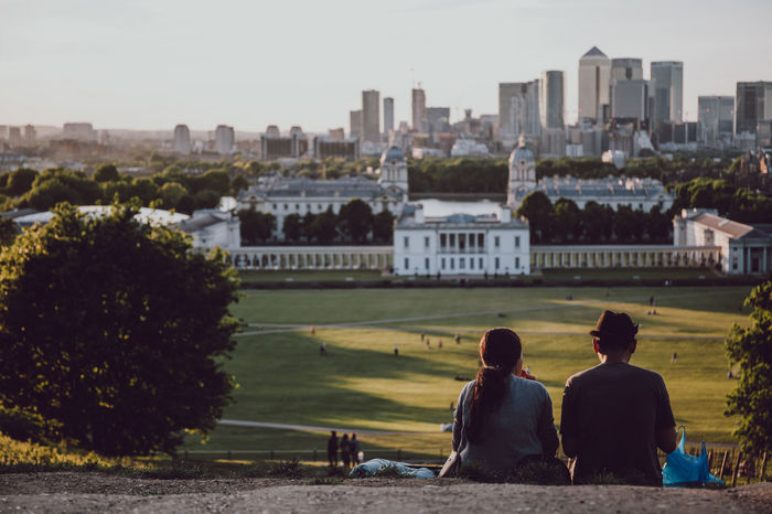 City Life Couple Greenwich Greenwich Park Holidays London Picnic Skyline Travel City Cityscape Dusk In The City Focus On Foreground Friendship Outdoors Real People Rear View Sitting Sitting On The Ground Summer Together Togetherness Travel Destinations Two People Weekend Activities Colour Your Horizn