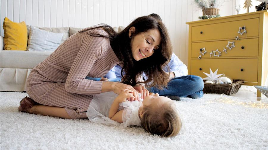 Happy woman lying down on floor