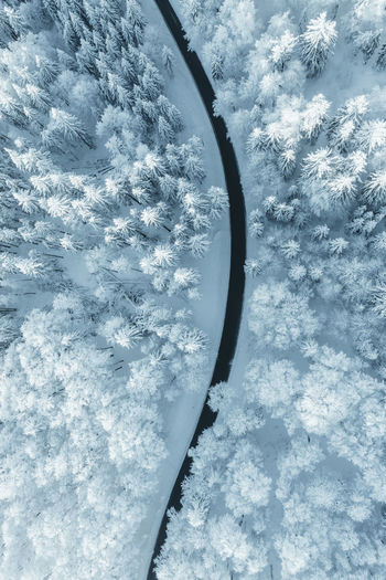 Snow on road against sky during winter