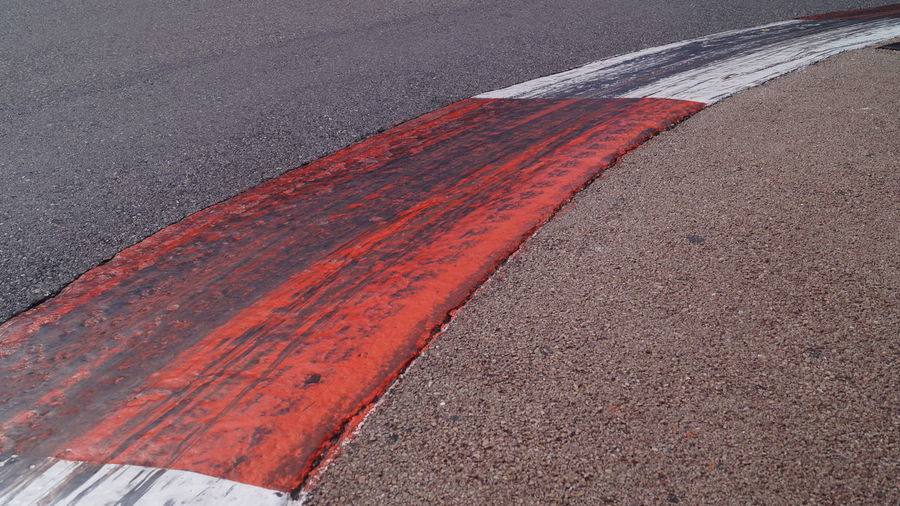 Close-up of red road marking