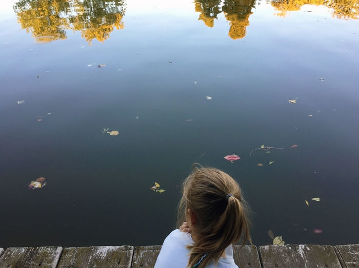 Contemplating autumnal beauty Autumn Reflection View Blond Hair Child Childhood Color Girl Girls Hair Hairstyle Headshot Lake Lake View Lakeside Leaves Leisure Activity Lifestyles Nature One Person Peaceful Real People Unrecognizable Person Water Waterfront A New Beginning