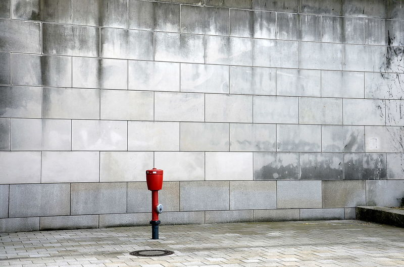 Fire Hydrant Against Wall