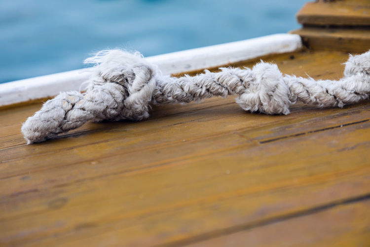 Close-up of rope tied on wooden table
