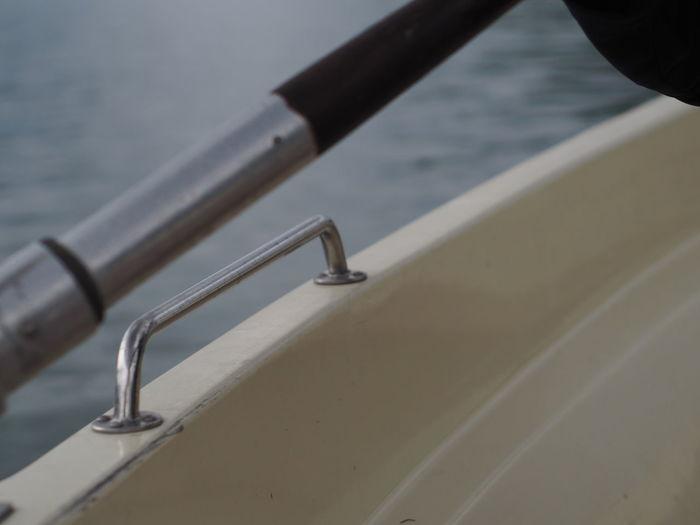 High angle view of metal railing by lake