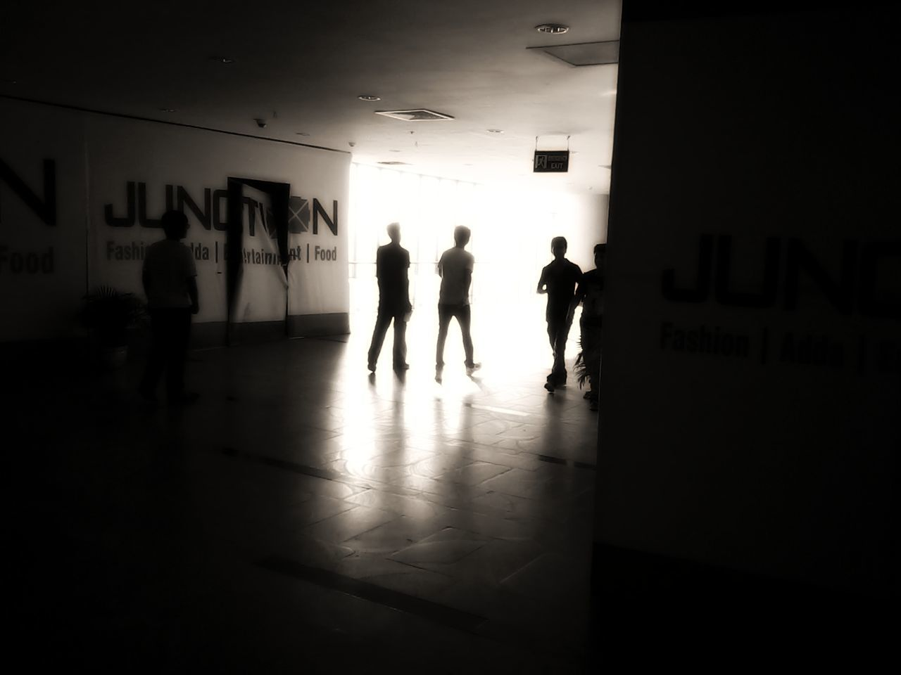 text, silhouette, real people, indoors, men, leisure activity, women, architecture, built structure, full length, day, people