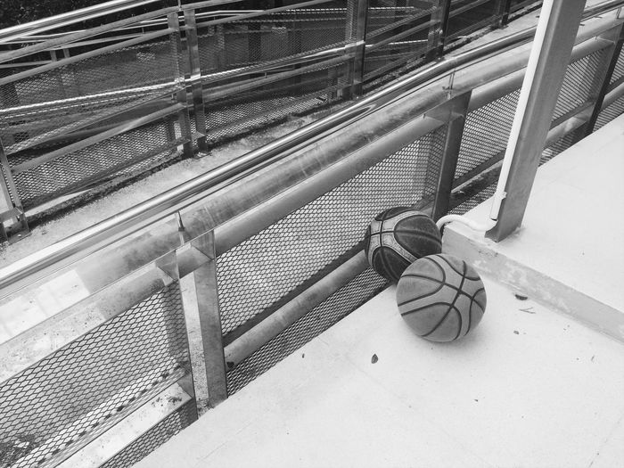 High angle view of balls by railing