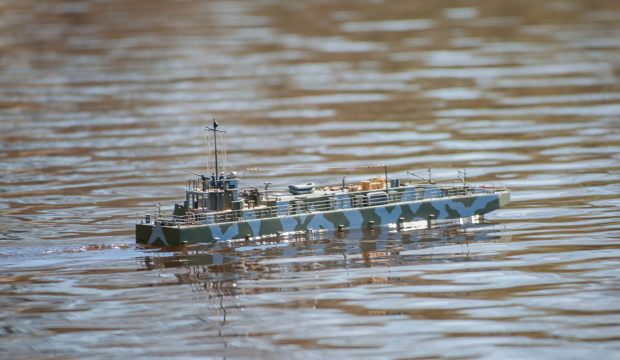 Remote controlled ship model is remote controlled on a lake