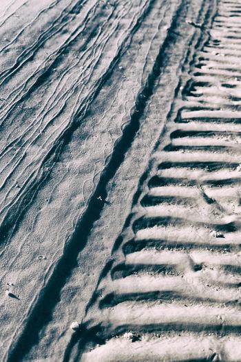 Full frame shot of tire tracks on snow