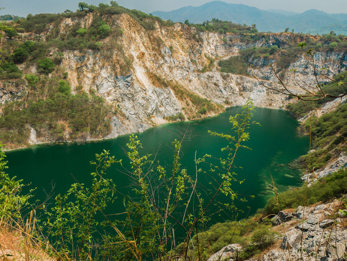 GRAND CANYON CHONBURI Thailand. Mountain Scenics - Nature Water Beauty In Nature Tranquil Scene Nature Tranquility Rock Lake Day No People High Angle View Non-urban Scene Mountain Range Land Plant Rock - Object Environment Landscape Outdoors Formation Turquoise Colored Mountain Peak Tree Green Water Blue Sky Green Water Grand Canyon Thailand Stone Material Stone Old Mine
