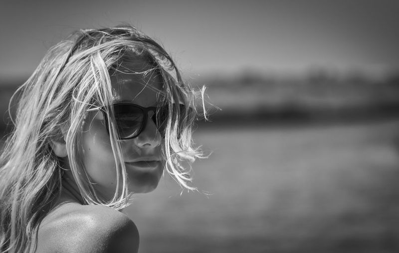 Side view of woman wearing sunglasses