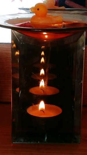 Candle Relection in a Mirrored Oil / Wax Burner with a Yellow Duck Wax Melt Floating in the Top . Featuring Candle Indoors  Close-up Day No People Flame Burning Melting Craft Relaxation Alight Homemade Relaxing