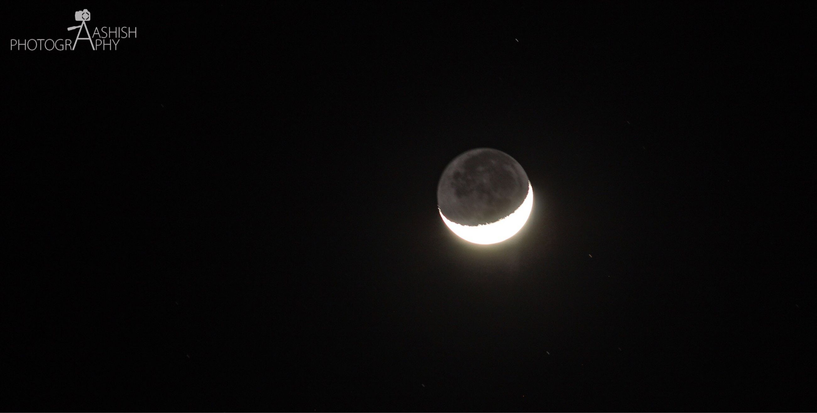 astronomy, night, moon, beauty in nature, low angle view, nature, space, outdoors, no people, scenics, tranquility, tranquil scene, natural phenomenon, sky, planetary moon, solar eclipse, moon surface