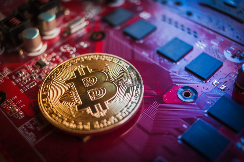 bitcoin cryptocurrency token on a computer graphics card Bitcoin Cryptocurrency Blockchain Blockchain Technology Mining Encrypted Cyber Computer GPU Mining Graphics Card Circuit Board Electronic Money Currency Decentralized Business Tech Finance Banking Savings Investment Financial Wealth Circuit