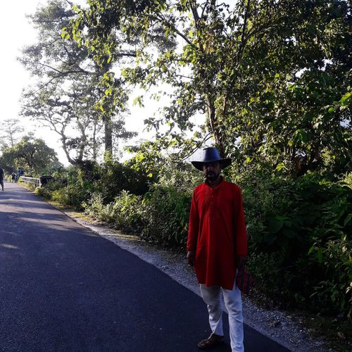 Full length of man wearing hat standing on road