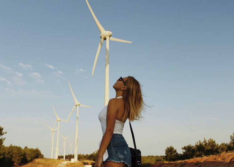 Windmills. Backgrounds Nature Naturelovers Summertime Windmill Blond Hair EyeEmNewHere EyeEm Gallery EyeEm Best Shots EyeEm Selects EyeEm Nature Lover Renewable Energy Fuel And Power Generation Alternative Energy Turbine Environmental Conservation Wind Turbine Wind Power Environment Sky Hairstyle Young Adult One Person Long Hair Standing Nature Lifestyles Hair Technology Wind EyeEmNewHere EyeEmNewHere