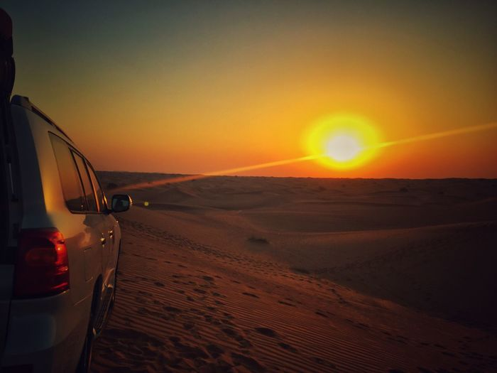 The Drive Twilight Sky Twilight Desert Sunset Sun Beauty In Nature Transportation Orange Color Nature Scenics Travel Tranquility Sky Tranquil Scene Car Landscape Off-road Vehicle Sand Adventure No People Outdoors Vehicle Mirror Day