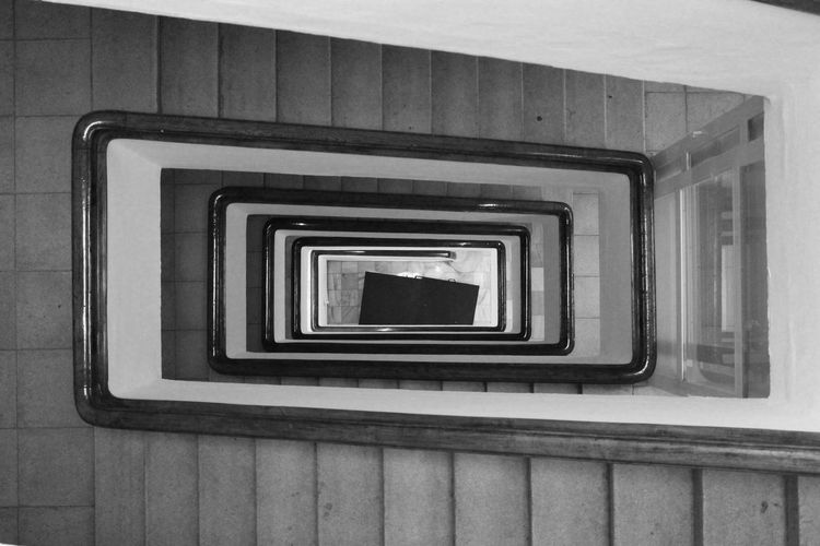 Stairs Architecture Black And White Blackandwhite Built Structure Day Design Diminishing Perspective Directly Above Directly Below Downstairs High Angle View Indoors  Low Angle View No People Pattern Railing Repetition Shape Spiral Spiral Staircase Staircase Steps And Staircases Wall - Building Feature