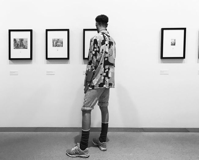 Rear view of man standing in museum