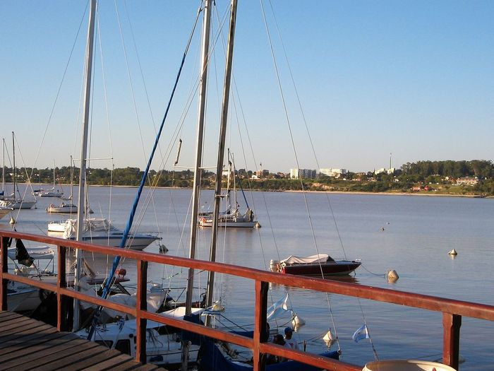 The Old Wharf at Colonia del Sacramento, Uruguay. Yachts. Houses on the opposite shore. Boats⛵️ Bridge - Man Made Structure Clear Sky Coastal Town Colonia Del Sacramento - Uruguay Day Nautical Vessel No People Outdoors Puerto Rio De La Plata Sailboat Sailing Boat Sea Sky Water Wharf Yachts