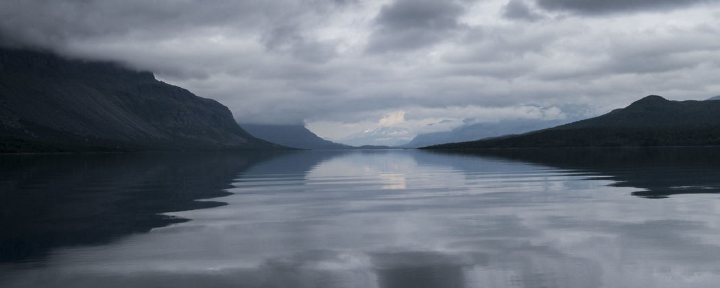 Beauty In Nature Calm Cloudy Hiking Adventures Kayaking In Nature Kungsleden Lake Majestic Mountain Mountain Range Nature Reflection Remote Rippled Saltoluokta Scenics Tranquil Scene Tranquility Water Weather