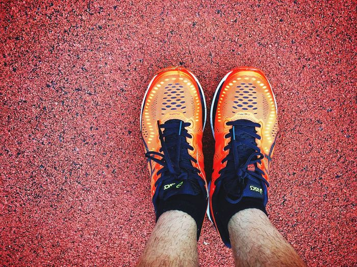 Shoe Low Section Human Leg High Angle View Directly Above Human Body Part Personal Perspective One Person Real People Standing Lifestyles Day Men Adult Outdoors People Adults Only Only Men Run Running Wall Floor Foot Footwear Sport