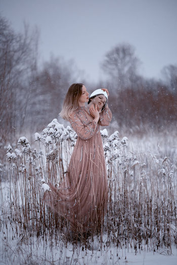 Woman in snow on field during winter