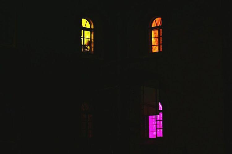Illuminated house window at night