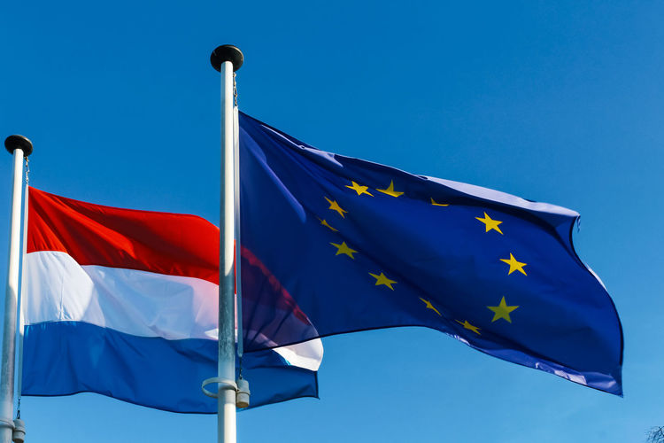 Blue Flag Patriotism Sky Wind Environment Clear Sky No People Waving Low Angle View Nature Day Shape Star Shape Sunlight Outdoors Striped Pole Pride Independence National Icon Europe European Union Luxembourg Luxembourg Flag
